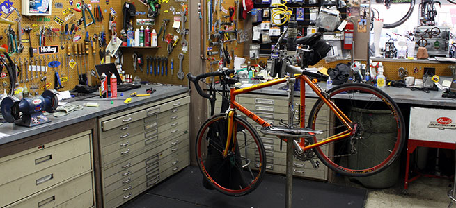 bicycle repair shop with bike and tools