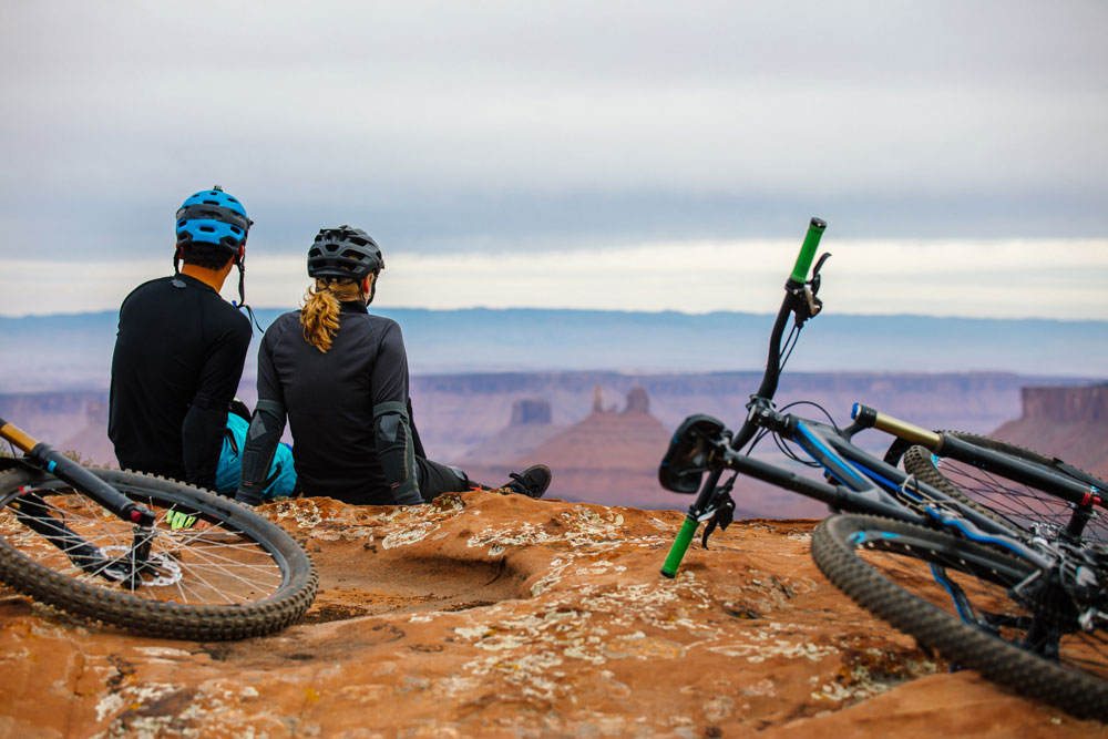 two people resting while mountain biking